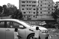 A dream of their own (A. adnan) Tags: hillview chittagong bangladesh monochrome reality dream car vehicle difference poverty rich juxtaposition humanity dreams gap