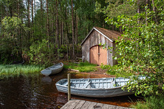 Three Boats and a Boathouse (Geoff France) Tags: fishing troutfishing lake mere loch lochfarr highlands scottishhighlands scotland landscape scottishlandscape water trees rowingboat