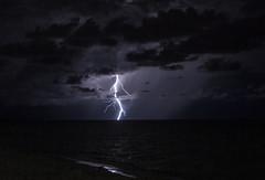 Slight Reflection (lightonthewater) Tags: lightning lightonthewater thunderstorm gulfofmexico reflection light storm sand ocean clouds cloudy florida floridathunderstorm