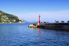 Relaxing in Dubrovnik (Jocelyn777) Tags: seascapes landscapes adriaticsea mediterranean people reflections waterreflections dubrovnik dalmatia croatia balkans travel
