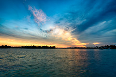 Sunset over Cinco Bayou (mikewhalenphotography) Tags: sunset sun sky clouds ocean water reflection dusk evening landscape bay bayou warmth