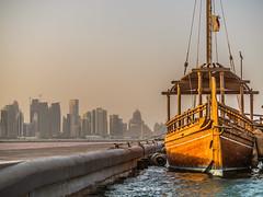 Dhows of Qatar (LensReady) Tags: sea boat woodenboat vintage afternoon sunset light microfourthirds olympusem1 panasonic45200 pier dock heritage jetty gutter city urban oldandmodern culturalheritage hightide
