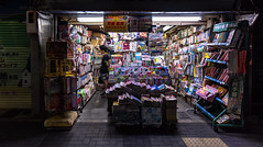 Looking for a magazine (Kyoto) (Andreas Mezger - Photography) Tags: kyoto asia japan magazin mange comic reading night street streetphotography ambient light photography ambientlight nikon