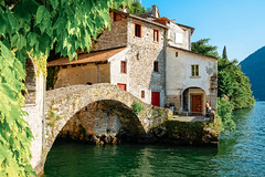 Old bridge on sunset (Luca Quadrio) Tags: ancient european lake view building medieval landscape nature water lombardy italy horrid vacation destination holiday italian old famous summer urban scenery village travel stone scenic como architecture nesso bridge tourism europe mountain