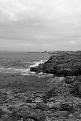 Risky fishing (José J. Almuedo) Tags: streetphotography people ocean pesca fishing olas mar mediterráneo wave blackandwhite 35mmbw leicax1 leica spain menorca mediterranean seashore cliff sea rockycoastline seascape seasline coast coastline