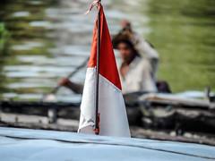 Life is struggle (A. Yousuf Kurniawan) Tags: flag indonesia rowing blackandwhite boater river riverlife water people borneo kalimantan banjarmasin streetphotography colourstreetphotography rural rurallife humanity humaninterest