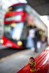 Matreshka in London 🇬🇧 (valerian.guillot) Tags: matryoshka matrioshka matreshka bokeh street red doubledeckers bus russian london canon otus otus1428 ze  imperial