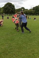 Historia Normannis Meadows June 2018-595 (Philip Gillespie) Tags: historia normannis central scotland sparring fighting shields swords axes spears park grass canon 5dsr men man women woman kids boys girls arms feet hands faces heads legs shins running outdoor tabards chain mail chainmail helmets hats glasses sun clouds sky teams solo dead act acting colour color blue green red yellow orange white black hair practice open tutorial defending attacking volunteer amateur kneeling fallen down jumping pretty athletic activity hit punch