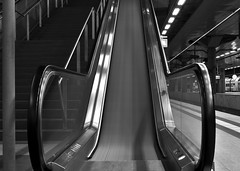 Silver Side Up (Robin Shepperson) Tags: station trains escalator exposure long d3400 nikon berlin germany stairs blackandwhite bw monochrome light grayscale transport engineering black white