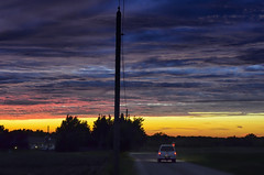 Over the Escarpment (Paul B0udreau) Tags: nikkor50mm18 photoshop canada ontario paulboudreauphotography niagara d5100 nikon nikond5100 raw layer sunset telephonepole car silhouette escarpment rural