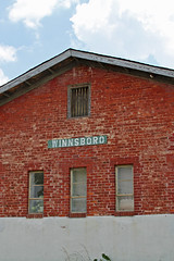 rrdepot3 (FAIRFIELDFAMILY) Tags: winnsboro train depot station granite blue fairfield county sc south carolina sunflower field jason taylor grant yellow pretty outside farm farming nature young old architecture stone brick building store town southern living garden gun fun flower flowers summer life boy warehouse