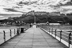 Saltburn Pier  (2) (Rich Presswood) Tags: fuji fujixpro2 7artisans 25mmf18 bw blackandwhite mono monochrome black white apsc saltburnbythesea pier people northeast eastcoast seaside silverefexpro2 adobelightroom