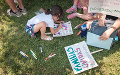 Last-Minute Sign-Making at Lafayette Park (ep_jhu) Tags: grass crowds x100f nena washington writing antitrump drawing familiesbelongtogether rally protest fujifilm girl separation immigration niña fuji making lafayettesq family familiesbelongtogethermarch signs dc districtofcolumbia unitedstates us