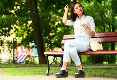 in the park (toivo_xiv) Tags: kyiv ukraine park summer sunlight bench beauty girl purse pretty green greenlight