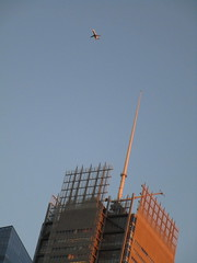 Evening Flight Plane flying over NY Times Building 5151 (Brechtbug) Tags: evening flight plane flying over new york times building city nyc 2018 above blue sky travel airplane jet fly air craft traveling commuting trip march 07082018 worms eye view from below sun set sunset tower spike spire roof