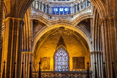 gothic lines 哥特线条 (nzfisher) Tags: gothic architecture building interior spire arch stainedglass church catedraldebarcelona catedral 85mm canon barcelona spain travel holiday orange yellow column