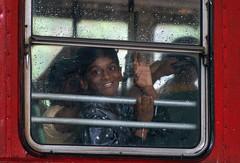 Faces, Mumbai (reinaroundtheglobe) Tags: mumbai india child smiling bus behindwindow rain people daytime
