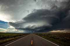 Supercell Highway (Sebastian Hobbs) Tags: canon supercell hail rain thunderstorm severethunderstorm tornado storm stormchasing cloudsstormssunsetssunrises wyoming unitedstates northamerica weather highway leadinglines mothernature nature earth clouds cloudporn cloudscape natural intense lonely wywx landscape desolate 5dmarkii gorgeous