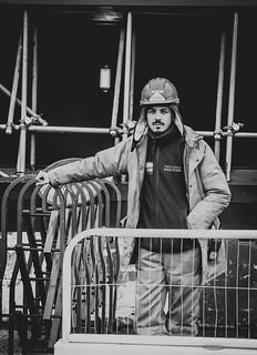 Men at work.   #sondela #portraitcentral #graphic #portrait #friendsinperson #urbanphotographer #streetshot #streetportrait #capturestreet #pursuitofportraits #menatwork #lightandshadow #urbangeometry #thisislondon #art #streetphotography #nikon #bnw #lon