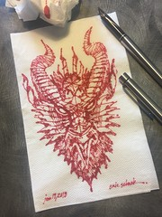 Reddish dragon (schunky_monkey) Tags: penandink ink pen fountainpen illustration art drawing draw sketching sketch napkin firebreather creature mythical dragon