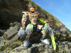 Resting. (Working hard for high quality.) Tags: toy bionicle figure stone blue cliff beach uniter lego action warrior toa