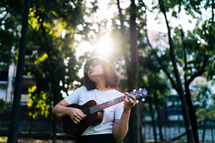 The talented Fairooz. (A. adnan) Tags: blue music ukulele bangladesh flare sunlight chittagong musician relax realpeople