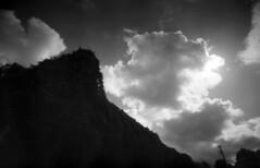 Summer Remains (Sean Anderson Media) Tags: summer ruin vines desolate silhouette moody clouds plasticlens plasticcamera toycamera lofi blackandwhite blackandwhitefilm 35mmfilm ilford ivy superheadzultrawideandslim superheadz dramaticclouds landscape sky monochrome 22mm wide ultrawideandslim