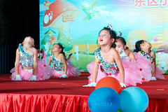 Happy Day Kindergarten Graduation 380 (C & R Driver-Burgess) Tags: stage platform ceremony parent mother father teacher child kids boy girl preschooler small little young pretty sing dance celebrate pink dress skirt red white blue bowtie 台 爸爸 妈妈 父亲 母亲 父母 儿子 女儿 孩子 幼儿 粉红色的 衬衫 短裤 篮球 跳舞 唱歌 漂亮 帅 好看 小 people gauzy compere 打篮球 短裤子 黑 红 tamronspaf2875mmf28xrdildasphericalif 6yrsold text writing sign balloons ballet gloves tights stretch group sit lean cup reach 同学 班 tutu
