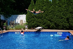 The flying Greek! (ineedathis, Everyday I get up, it's a great day!) Tags: christopher diving swimmingpool justin eleni family fathersday2018 flying nikond750 trees arborvitae