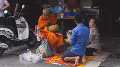 Something Funny (Shane Hebzynski) Tags: thailand bangkok monk buddhist buddhism blessing ritual people women man street outdoor