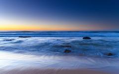 Sunrise Seascape (Merrillie) Tags: daybreak sunrise nature water clearskies cloudless bluesky macmasters centralcoast newsouthwales rocks earlymorning nsw morning sea ocean dawn waterscape landscape coastal macmastersbeach outdoors seascape australia coast sky waves