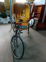 Your Chariot Awaits (Steve Taylor (Photography)) Tags: cycle rickshaw chariot tricycle cabinet pole canopy bike brown yellow newzealand nz southisland canterbury christchurch junkshop pumphouse saddle