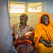 (Left) Hawa Yimam, 35, smiles as she holds her one-day-old son Musa Mohammed