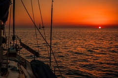 There I was on a July morning....... (Dafydd Penguin) Tags: uriah heep july morning sea sail sun sunrise yacht yachting sailboat cruise cruising water ionian golfo di taranto crotone santa maria leuca calabria lecce italy boat vessel mediterranean orange leica m10 7artisans 50mm f11