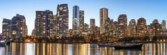 Yaletown Night Panorama (Patrick Lundgren) Tags: vancouver british columbia canada pacific northwest downtown yaletown false creek buildings real estate water reflections panorama night long exposure city cityscape boat trees park scenery sony a7 rii a7rii blue yellow camera photography