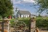 PICT5333.jpg (frankraney130@gmail.com) Tags: bluesky redoak dcr044903 church old buildings wagonwheel minister clouds