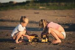 heavy machinery (raisalachoque) Tags: summer sand children sunset beach toys playing kids