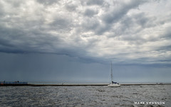 Safely Home (mswan777) Tags: 1855mm nikkor d5100 nikon wave water sky michigan stjoseph coast shore seascape scenic sail harbor safe boat sailboat lighthouse pier river nature outdoor storm wind rain cloud