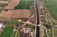 The village of Schoorldam. (Alex-de-Haas) Tags: dji derekere dutch europa holland nederland nederlands netherlands noordholland noordhollandschkanaal phantom phantom4 phantom4pro schoorldam uav warmenhuizen aerial aerialphotography air canal drone kanaal landscape landschaft landschap lente lucht luchtfotografie polder skies sky skyscape spring sundown sunset village water waterway waterweg zonsondergang nl