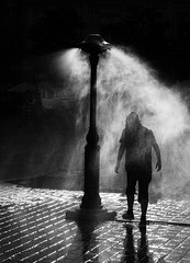 Cooling Off (D-W-J-S) Tags: forflickr krakow poland spray water shower city square silhouette backlit