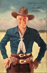 """Cowboy Movie Actor """"Hopalong Cassidy"""" (Bill Boyd). Postcard A40A published by Movie Candid Color Card of Beverly Hills, Calif. (1949) (lhboudreau) Tags: motionpicture movie star celebrity actor cowboy gun holster sixgun cowboyhat hat hollywoodstar hollywoodactor postcard postcards vintagepostcard pose posing a40a postcarda40a cowboyoutfit western classicwestern hopalong hoppy hopalongcassidy billhopalongcassidy cassidy movieactor cowboymovieactor billboyd williamboyd 1949 cowboyhero hero fictionalcowboy clarenceemulford mulford moviecandidcolorcard colorcard americanwest scarf gunbelt glove gloves portrait leather leatherbelt colorized blackhat"""