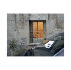 The window.  ( Navarra ) (José Luis Cosme Giral) Tags: thewindow minimalism wall car urbannature grass sky peripheralplace textures olympus navarra