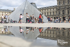 Louvre puddle (Lonely Soul Design) Tags: louvre museum pyramid puddle water reflection paris