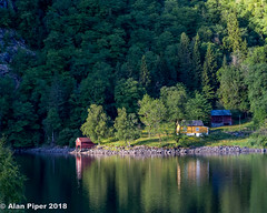 Norwegian Fjord (PapaPiper (Travelling with my camera)) Tags: norway lake water fjord house forest mountain trees habitation building reflection