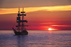 Sunset in Visby, Sweden (Jukka Sundberg) Tags: absolutelystunningscapes jukkasundberg sky clouds seascape sun water sea colours sailboat archipelago sweden visby sunset