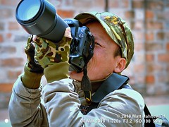 2016-03a Photographing Photographers 2018 (10) (Matt Hahnewald) Tags: matthahnewaldphotography facingtheworld head oneeye expression lookingatcamera story dslrcamera lens telephotolens nikon headwear camouflage fieldcap gloves fingerless bothhands finger consent rapport fun candid concept culture lifestyle business brotherhood photoshoot photographer hanoi vietnam asia vietnamese asian individual oneperson male middleaged man photography image photo detail nikond3100 nikkorafs50mmf18g primelens 50mm 4x3 horizontal street portrait halflength closeup twothirdview outdoor color cool iconic awesome photographing aimingcamera takingphoto sunglasses posing