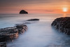 Trebarwith Strand, North Cornwall at Sunset (ianperkins11) Tags: trebarwith strand beach sun sunset north cornwall kernow long exposure seascape landscape island rocks cliffs tide orange sky glow golden hour smooth tintagel horizon sea