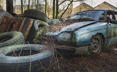 Car Crash (ProfShot - Perry Wiertz) Tags: urban urbex urbenexploring car cars cargrave grave rusty rust dust metal parts hidden lost old abandoned decayed decay derelict weels tires mold garden graveyard light