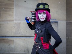 Comic Con (Leanne Boulton) Tags: portrait cosplay glasgowcomiccon2018 urban street pose posed portraiture streetphotography streetportrait eyecontact streetlife comiccon comic convention event costume character woman female face eyes posture stance look mood atmosphere pink hair tone texture detail naturallight outdoor light shade city scene human life living humanity society culture people lifestyle canon canon5d 5dmkiii color colour ef2470mmf28liiusm glasgow scotland uk