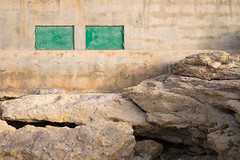 Sorowaji (That James) Tags: malta europe med island medeterranean rocks rocky sharp jagged natural picturesque blending contrast limestone sandstone beach shore building built architecture manmade closed windows shut green painted painting abstract view photography rendering plastering plaster plastered shutter bugibba stpaulsbay resort